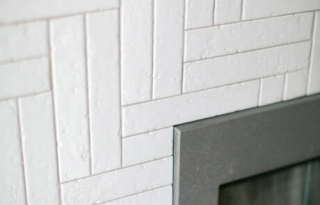 Herringbone tile fireplace detail